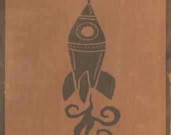 Rocket. B/W print on wood.