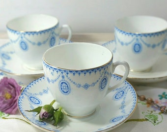 Vintage tea cup and saucer in blue and white made from english bone china.