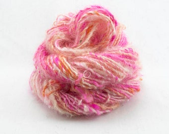 Handspun Yarn. Single from Kid Mohair locks. Dyed in hot pink, peach and natural white