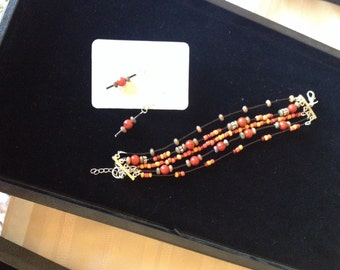 Red and black multi strand beaded bracelet and matching earrings