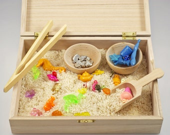 Wooden sensory box of trinkets, rice, wooden bowls, tongs and scoop, Montessori material, transfer work, Waldorf learning toy, Preschool toy