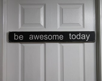 Black and White BE AWESOME TODAY sign painted on  reclaimed wood.