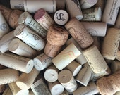 75 assorted wine corks- synthetic and natural