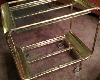 Cool Mid century brass and glass tea cart