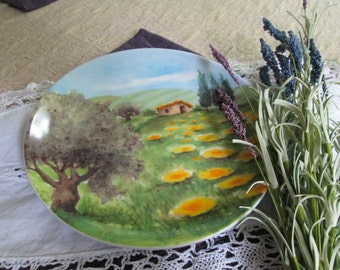 A decorative plate of the French Country side.