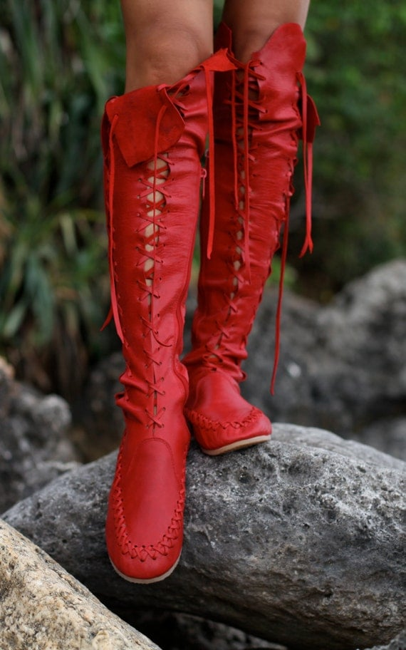 Handmade red leather lace up boots for women.