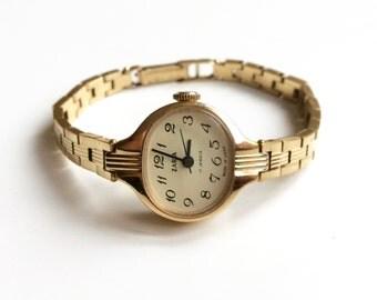 Часы заря 16 камней ссср женские цена