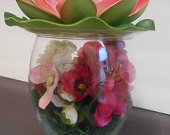 Glass encased floral arrangement