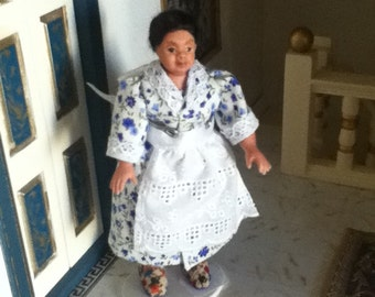 Maid, servant.