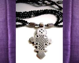 Lalibela Sparkle: Vintage Ethiopian silver cross, Bali silver, Swarovski crystals. Necklace and earring set.