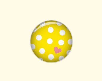 Dotted button in yellow with white dots