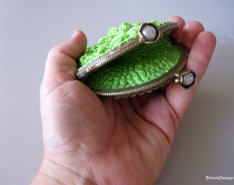 Light Green Crochet Frame Coin Purse. Flower Shaped and Feautirng a Silver Colored Clasp