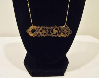Gear Line Necklace: Pierced Brass