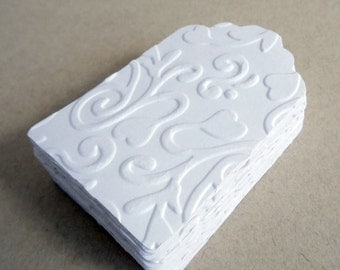 Embossed white tags, set of 10 pieces