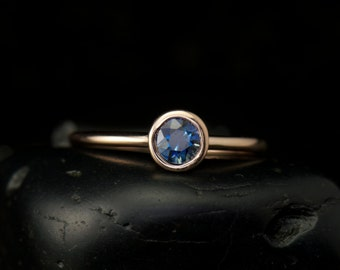 Emerson Sara - Blue Sapphire Engagement Ring in Rose Gold, Round Brilliant Cut, Bezel Set Solitaire, Open Profile, Stackable, Free Shipping