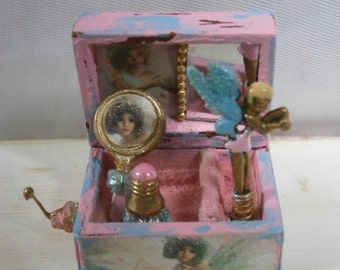 Old damaged fairy Musical jewelry box.