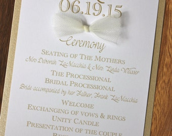 gold and white flat layered wedding program