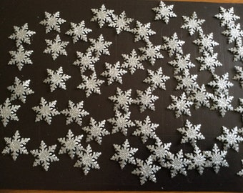 55 hand punched alpine snowflakes