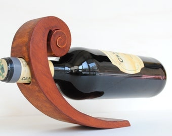 Wooden balancing wine bottle holder