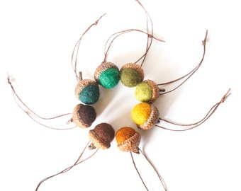 "Set of felted wool acorns in harvest hues.  8 Woodland colors, Fall decor.  Large caps approximately 1"" diameter"