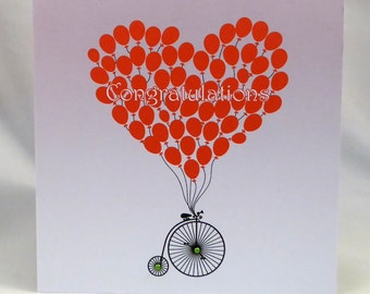 Red balloons in a shape of heart-Congratulations card