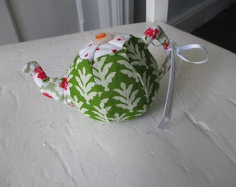 A quirky teapot shaped pincushion