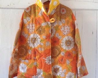 Girls Orange Floral Jacket.Size 6 to 8.
