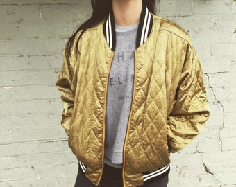 Saks Fifth Ave gold bomber
