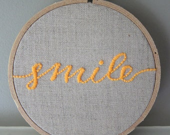 "Hand Embroidered 4"" Hoop Wall Art Neon Orange Calligraphic ""Smile"" Quote Saying on Natural Unbleached Linen"