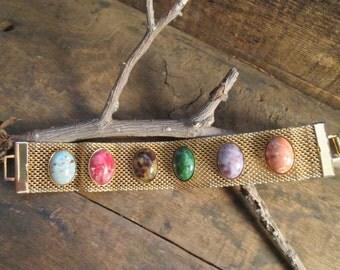 vintage gold tone sarah coventry mesh multi-colored cabochon bracelet