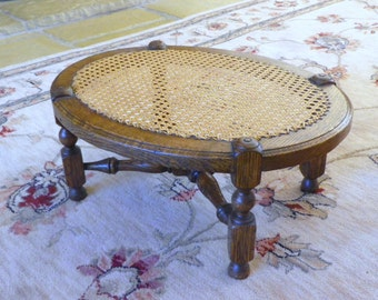 Edwardian Oak Footstool with caned seat and turned stretchers