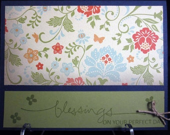 Handmade Wedding Card Wishing Blessings on their perfect day with floral paper and rich blue background