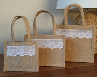 Beautiful hand finished Jute gift bag. Natural with pretty white Lace.