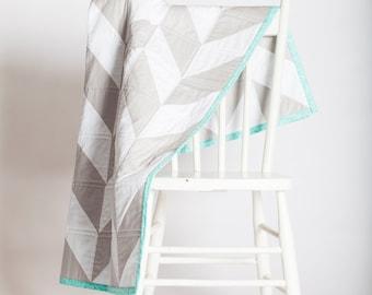 White & Grey Herringbone Crib Quilt with Aqua Backing