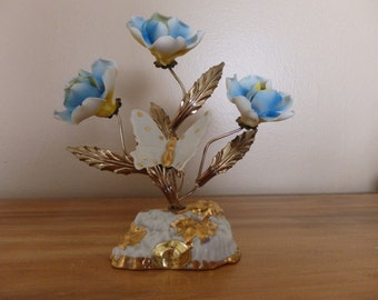 Vintage Capodimonte flowers and butterfly sculpture signed D Calle.  3 Blue flowers with ceramic butterfly on metal base.
