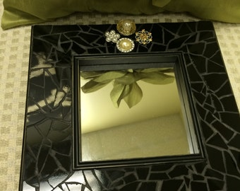 Black stained glass framed mirror