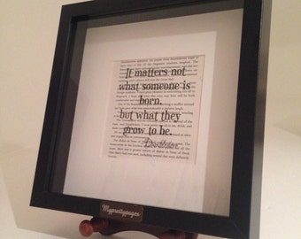 Framed Harry potter/Dumbledore printed quote on a harry potter book page.