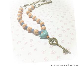 Bird unlocked -Bohemian style necklace- Blue and orange. Totem, key, turquoise, pendant, Artisan beads, key pendant.