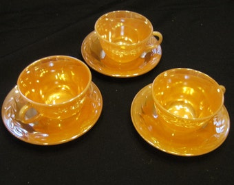 Trio of Vintage 1950's Fire King Peach Luster Tea Cups and Saucers
