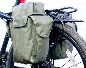 A pair of ex-army pannier bags in olive green fully waterproof vintage ex-army bicycle panniers shoulder bags NOS