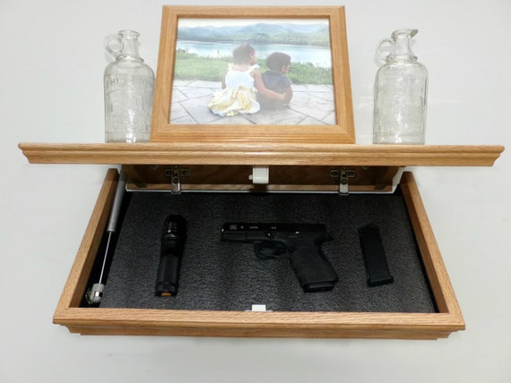 23 oak tactical wall shelf with drop down by for How to make a secret compartment in your wall