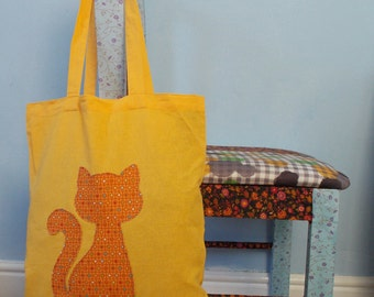 Yellow canvas tote bag with applique cat motif