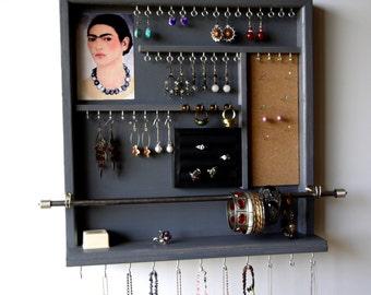 jewelry organizer. Earring holder. earrings display. jewelry display. Wall mounted Jewelry storage. Wooden Storage Frida. Gray bedroom.