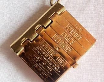 Miniature dictionary pendant
