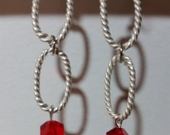 Dusty silver rings with sparkling crystal red cubes at the bottom.