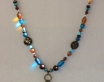 Turquoise and bronze feather pendant necklace