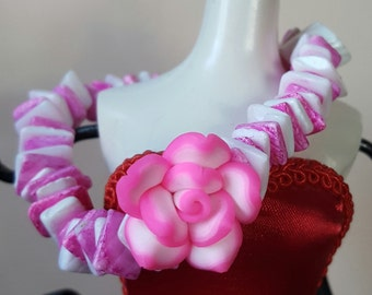 Pink and white flower bracelet.