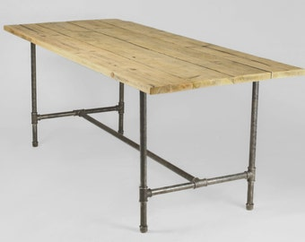 Dining table made from 1 inch gas pipe and reclaimed wood