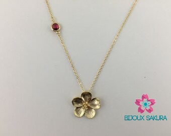 Gold chain necklace flower cherry blossom and red glass stone