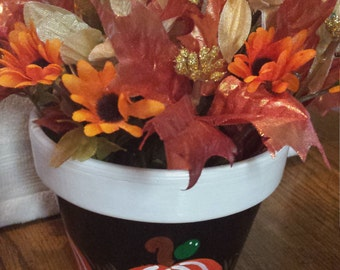 Fall flower pot with flowers